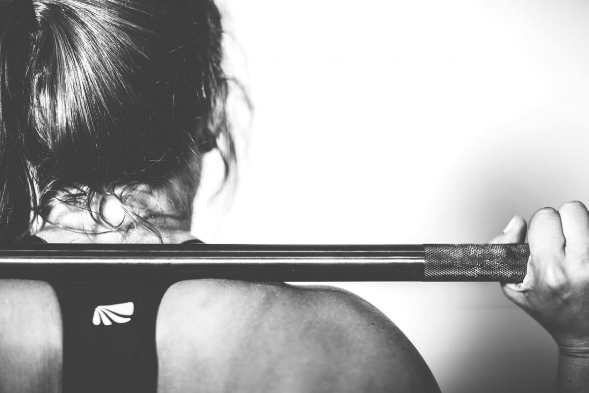 woman and barbell